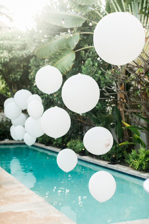 palm springs wedding // geronimo balloons floating by the pool