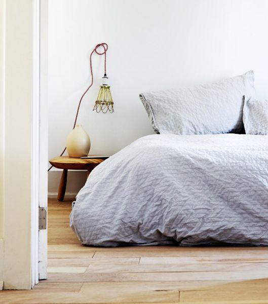 light blue bed in boho cottage